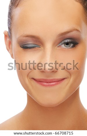 isolated close-up portrait of happy beautiful girl with healthy skin giving a wink - stock photo