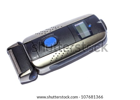 Isolated closeup of a mens black electric shaver. - stock photo