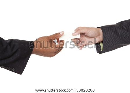 Isolated closeup studio shot of two businessmen reaching to exchange a business card - stock photo