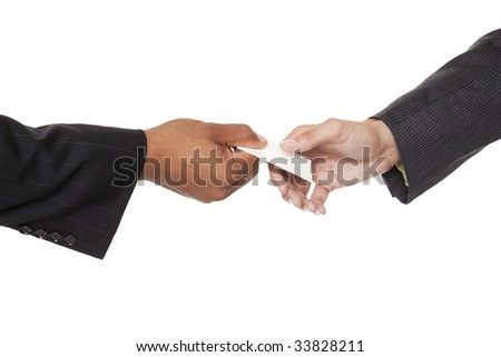 Isolated closeup studio shot of two businessmen reaching to exchange a business card