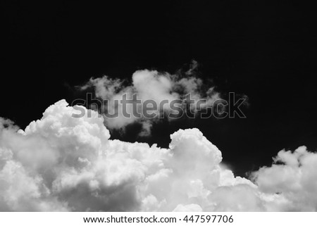 Isolated clouds over black.