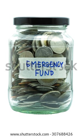 isolated coin in jar with emergency fund label