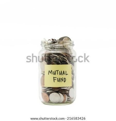 Isolated coins in jar with mutual fund label - financial concept - stock photo