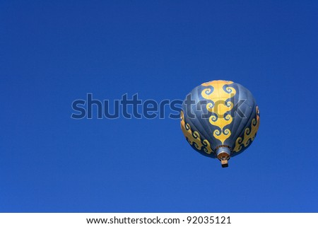 Isolated colorful hot air balloon floating in the sky - stock photo