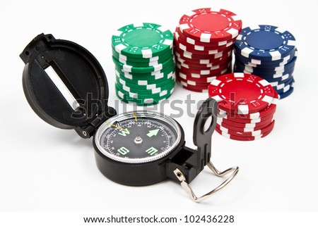 Isolated compass and red, green and blue chips over withe table