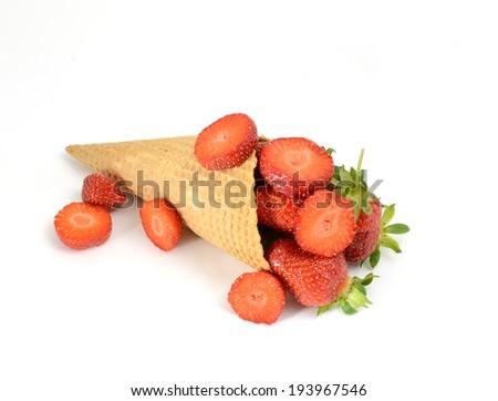 isolated cornet with fresh strawberry on white background - stock photo