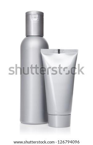 Isolated cosmetics tubes, white background - stock photo
