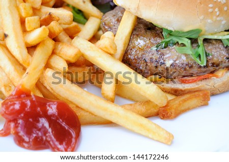 isolated delicious american cheese burger with fries in table