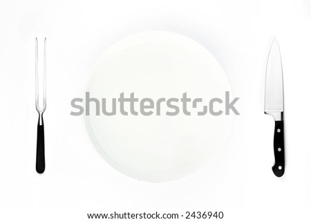 Isolated dinner setting on white background. Knife fork and plate. View from overhead. - stock photo