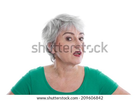 Isolated disappointed mature woman wearing green shirt looking angry. - stock photo