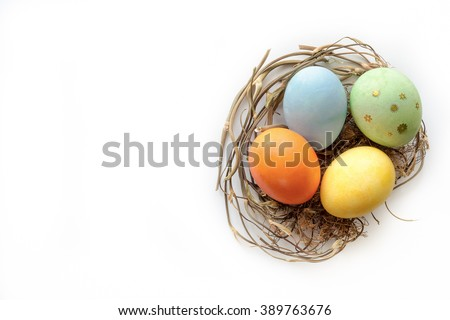 Isolated easter eggs in nest. Top view - stock photo