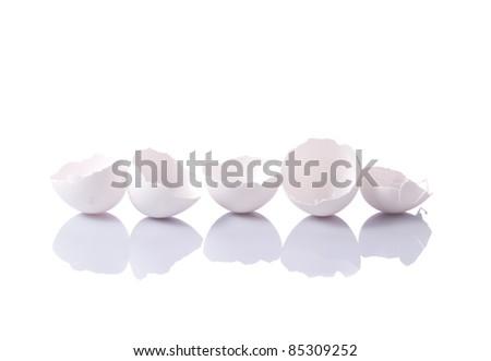 Isolated eggshells with reflection on white background - stock photo