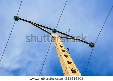 Isolated electric post from below - stock photo