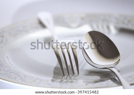 Isolated elegant Fork, spoon and plate for design