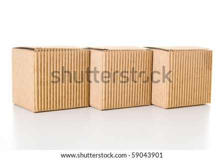 Isolated empty and closed cardboard boxes with reflection. - stock photo