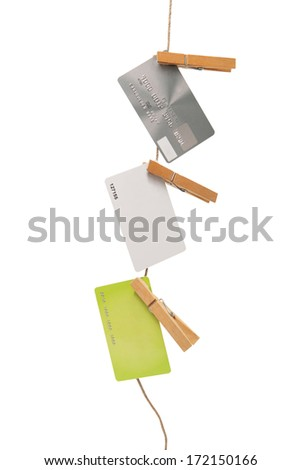 isolated empty credit cards hanging on a rope with space for your text - stock photo