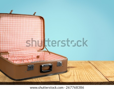 Isolated. Empty vintage open suitcase on white background - stock photo