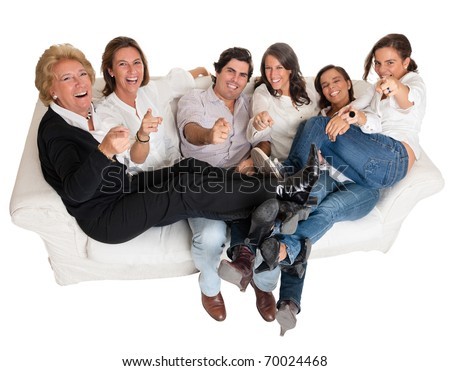 Isolated family group pointing at the camera happily laughing - stock photo