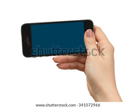 Isolated female hand holding a phone with black screen