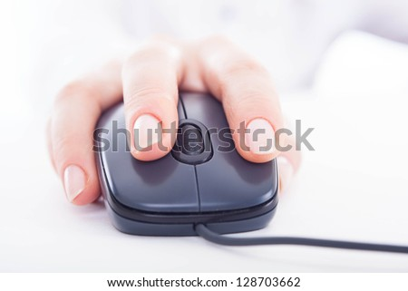 Isolated female hand on the mouse. - stock photo