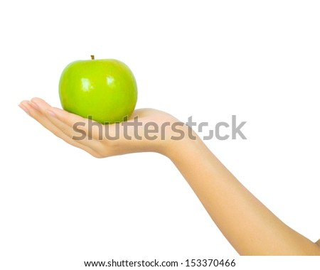 Isolated female hand with a green apple on white - stock photo