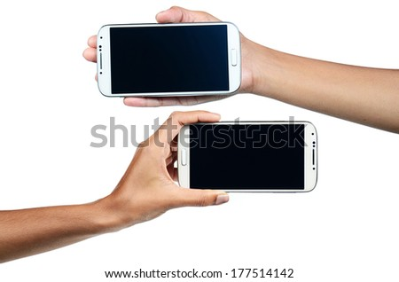 Isolated female hands holding phone