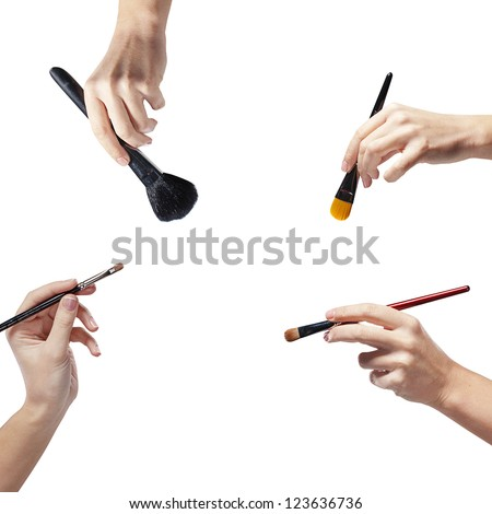 isolated female hands with a brushes for makeup - stock photo