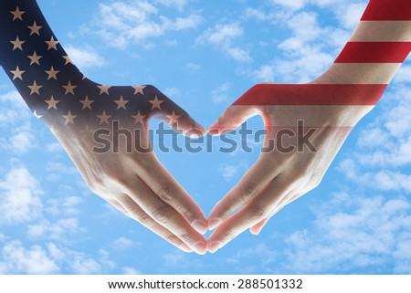 Isolated female human hands in heart shaped form with double exposure of the United States of America flag pattern on bright blue sky  background with clouds: USA Independence day and flag day concept - stock photo
