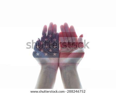 Isolated female human hands with open palms with the United States of America flag pattern on white background: USA Independence, Columbus, labor day, constitution and citizenship day - stock photo