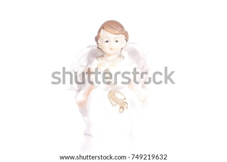 Isolated figure of an angel boy in white and on a white background
