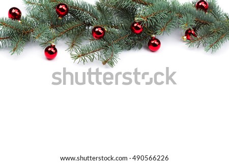 isolated Fir branches with Christmas tree balls.