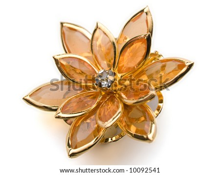 isolated flower broach ambercoloured on white background - stock photo
