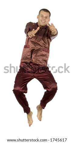 isolated flying pyjamas man - pointing - stock photo