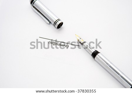 Isolated fountain pen ready to sign a paper - stock photo