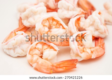 Isolated fresh and big boiled or cooked shrimps or prawns on white background - stock photo