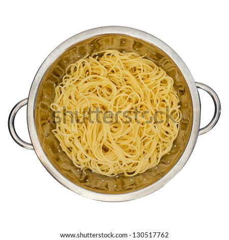 Isolated fresh spaghetti in a colander for pasta. - stock photo