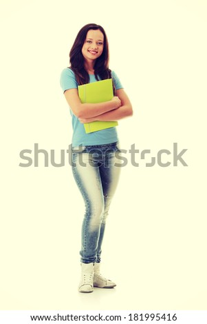 Isolated full length portrait of a beautiful young woman student.