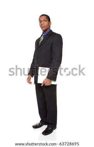 Isolated full length studio shot of a confident businessman looking at the camera while holding a laptop computer. - stock photo