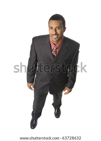 Isolated full length studio shot of an overhead view of a happy businessman smiling up at the camera. - stock photo