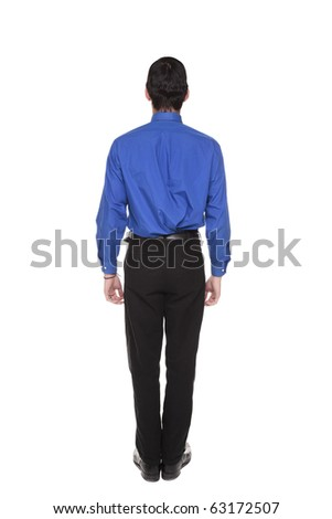 Isolated full length studio shot of the rear view of a Caucasian businessman standing with arms at sides and looking away. - stock photo