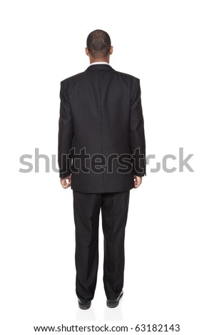 Isolated full length studio shot of the rear view of an African American businessman. - stock photo