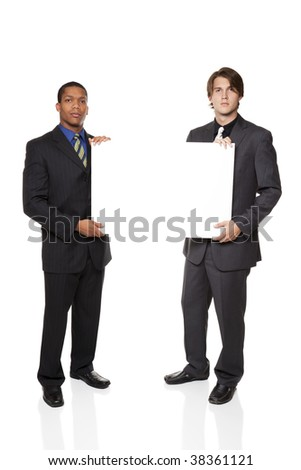 Isolated full length studio shot of two businessmen presenting a blank sign ready for your copy. - stock photo