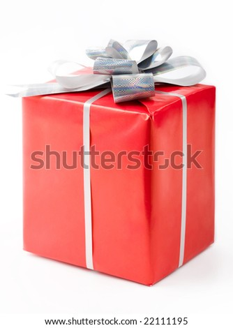 Isolated gift in red decorative box bound with silver ribbon and bow on its top - stock photo