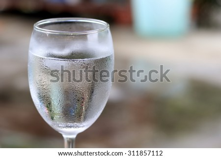 Isolated Glass of ice water. - stock photo