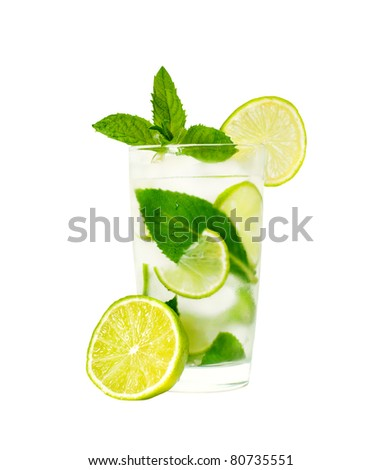 isolated glass of water with mint leaves and lime