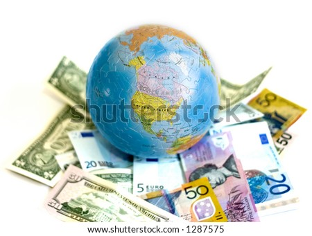 Isolated globe with world's currency - stock photo