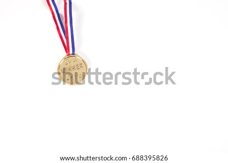 Isolated gold medal on a ribbon for the winner of a sporting event isolated on white with copy space