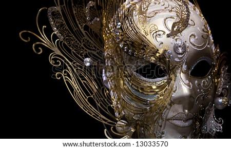 isolated golden mask on black background - stock photo