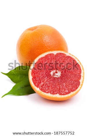 Isolated grapefruit with green leaves - stock photo