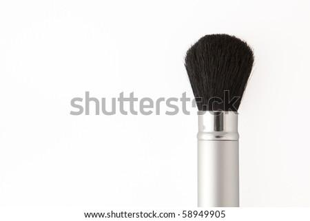 Isolated gray metal make-up brush on white background - stock photo